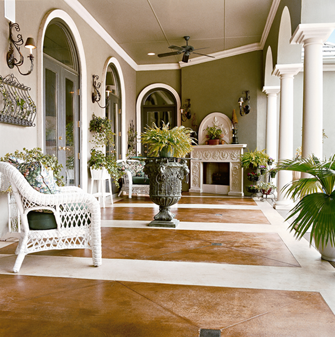 Gorgeous Outdoor Patio Design With Painted Concrete Flooring And White  Chairs And Arched Doors And Potted