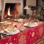 gorgeous red patterned table cloth idea with pine cone and acrylic candle holder and fireplace and golden table