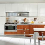 great and bright italian kitchen design with caramel tone cabinetry with dining set and modern chairs and white tile flooring and clock