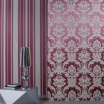 great pink retro wallpaper design with floral and stripe pattern and exotic geometrical shaped table with adorable table lamp