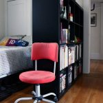 ikea-room-divider-expedit-in-black-color-with-red-chair-near-the-bed-separates-the-spaces-and-displays-decorations-and-books
