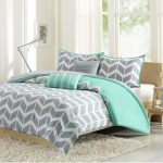 kayley-comforter-set-by-intelligent--design-with-a-chevron-print-and-vertical-stripes-along-the-bottom-also-the-comforter-and-shams-reverses-to-solid-gray-color