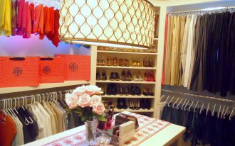 led closet lights installed in classy walk in closet design and combined with wood table and elegant lamp design