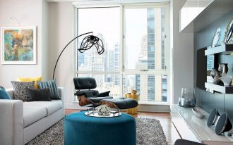 living room ideas for appartment with grey furry rug plus white loveseat sofa and colorful custion and modern living room tv media storage plus cool floor lamp