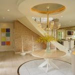 luxurious foyer design with suspended ceiling idea with round flooring pattern adn round table with indoor plant
