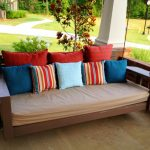 luxurious porch swing set design with brown upholster and colorful small cushions idea with jute rope