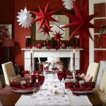 luxurious red country kicthen design with christmas decoration and white dining table centerpiece and luxurious chair and red table ware
