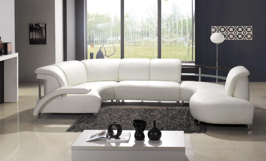 luxury white leather unique sectional sofas in modern living room with grey  furry rug and rectangular