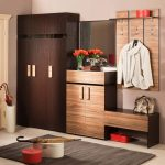 minimalist hall storage design idea with hooks clothers board and closet and dresser and bench and brown area rug and glass window and corner umbrella bucket