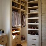 modern and elegant dressing room design with wooden siding and wooden storage for shoes and clothes and bags and wooden floor