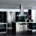 modern black and white kitchen decor with luxurious cabinetry and extended white kitchen bar and glossy flooring