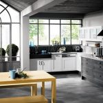 modern industrial black and white kitchen decor idea with white appliance and yellowish breakfast nook and arched glass window