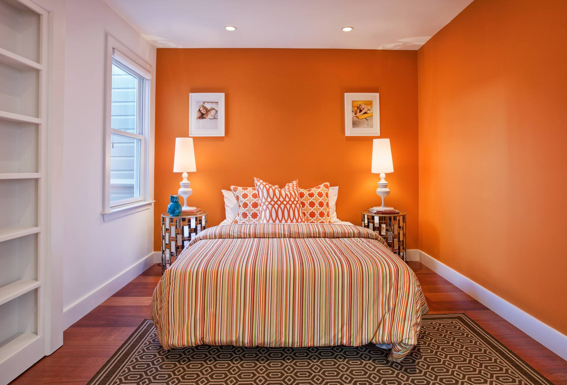 Orange Bedroom Color Ideas With Stripe Patterned Beddig Stunning Nighstands Table Lamps And