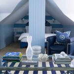 playful scandinavian small attic bedroom design with white blue wall pattern and white bedding adn stripe patterned area rug and glass console table