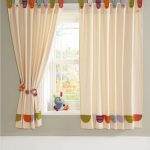 playful with blackout curtains nursery with colorful accents on its top and bottom of the curtain set on glass windows plus grey wall scheme