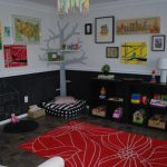 red pattern diy rug floor design in play room with wall pictures and storage and treeshaped bookshelves and black storage