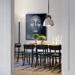 scandinavian home design with wodoen floor and lots dining table with black chairs and big vault pendant and wall picture