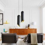 scandinavian interior with eclectic style with black chairs idea and black yellow pendants and wooden console table and white siding and glass window