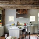scandinavian rustic kitchen idea with rustic wooden exposed ceiling and white island and black stools and glass window and gray cabinetry