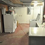 shabby chic basement laundry room idea with big storage and closet idea and painted concrete flooring