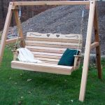 simple and traditional wooden porch ourdoor swing set idea with white blue cushions and jute rope suspension