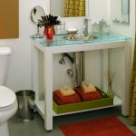 simple bathroom design with red area rug and traditional vanity with glass tray set and yellow patterned curtain