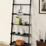 simple black conicle modern ladder booshelf design in white interior with wooden box storage beneath wall picture on wooden floor