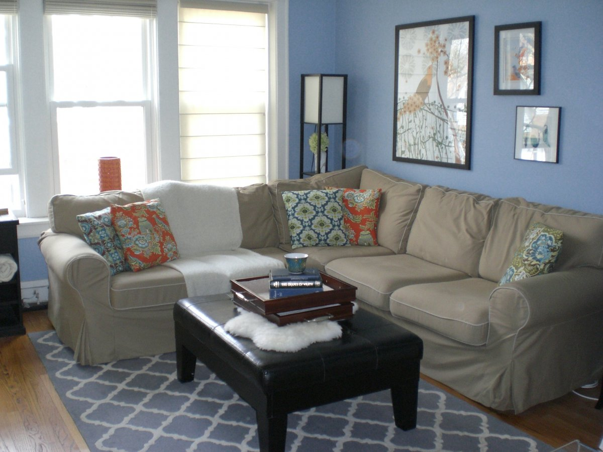 Simple Living Room Design Idea With Soft Blue Painted Wall And Pictures Glass Window