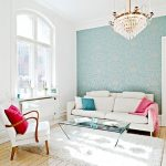 simple scandinavian home design with white sofa idea with turquoise cushion and pink throw and white chair with red cuhion and white area rug and wooden floor and arched window