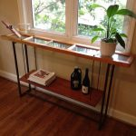 simple skinny sofa table with glass top and hanging shelf beneath plus greenery and wooden floor for awesome home decorating ideas