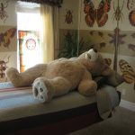 simple white best rated air mattress idea with wooden frame and wallpaper idea with animal print and teddy bear doll