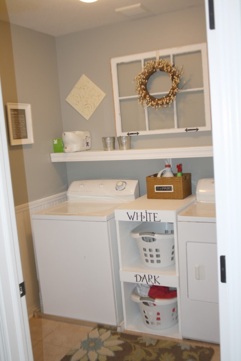 Small Basement Laundry Room Idea With White Cabinetry And Wall Rack And  Wreath And Storage Bins