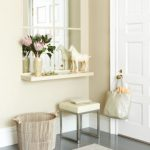 Smart And Elegant Entryway With White And Soft Color Theme Also A 'window' Mirror With Floating Shelf For Flowers And Horse Statue And Stool Underneath The Floating Shelf Near Wooden Bin