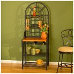 southern-enterprises-dome-bakers-rack-in-black-color-with-the-arched-top-and-metalwork-also-bottle-storage-utensil-hooks-and-two-shelves