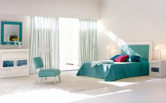 spacious bedroom design with turquoise paint on bedding and chair and storage and mirror and curtain and creamy area rug