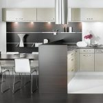 spacious black and white kitchen decor idea with black white cabinetry and black dining table and white chairs and black flooring and wallpaper