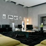 stunning grau living room design with corner tv console and floating cabinet and yellow sectional sofa and black area rug and pottery