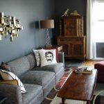 Stunning Gray Interior Design With Vintage Dresser And Floor Lamp And Classic Wooden Coffee Table And Gray Sofa Design And Wall Texture