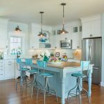 stunning light blue kitchen design with white cabinetry and light blue breakfast bar idea and metallic pendants and wooden floor
