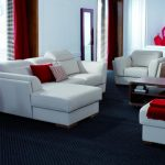 stunning red and white living room design idea with black area rug and red cushions and pottery and red curtain and white siding