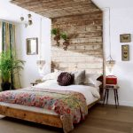 stunning rustic cherry wood headboard idea with white bedding and patterned red sheet and vintage nighstand and wooden floor and indoor plant
