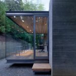 stunning sillicon valley idea with gray siding with glass wall idea with wooden floor and wooden ceiling and lighting