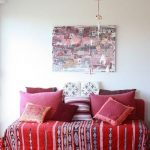 stylush pink cushion for sofa design with red ethnic patterned couch slipcover beneath unique wall picture and ball pendant