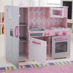 sweet and fancy pink kitchen ideas with pretty kitchen cabinets plus simple sink and small stove oven and cute rug area