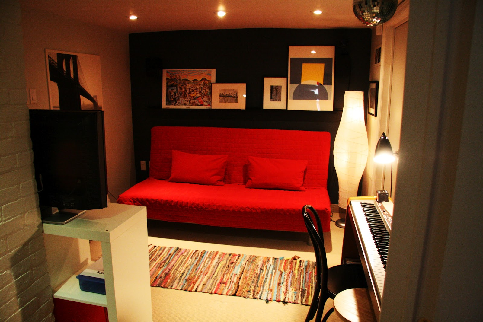 Unique Basement Media Room Design With Red Ikea Sofa Bed Design And Piano  With Black Chair