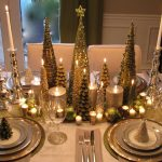 unique golden nativity idea for centerpiece with golden table cloth and acrylic candle holder and table ware