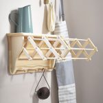 versatile-extending-clothes-airer-dryer-with-wooden-arms-and-four-pegs-underneath-and-a-top-shelf-for-laundry-attire