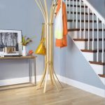 vinatge coat rack ideas made of rattan and bamboo in interior with blue paint and console table and picture and wooden floor and stairs