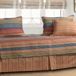 vintage daybed design idea with stripe patterned cushions and cover and metal frame idea