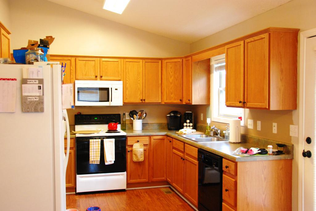 Warm Kitchen Makeovers On A Budget With Brown Kitchen Cabinets And Wooden Laminate Flooring And Modern